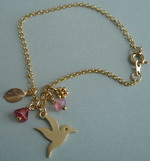 LITTLE DOVE MIXED CHARMS BRACELET