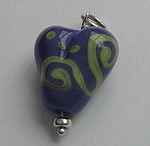 GLASS HEART BEAD~PURPLE WITH GREEN ACCENTS