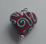 GLASS BEAD~RED WITH BLUE SWIRLS