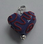 GLASS BEAD~PURPLE WITH RED SWIRLS